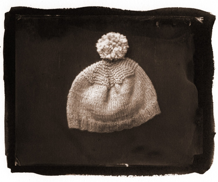 the birth cap she knitted for him