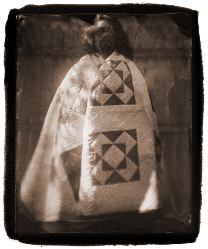 wrapped in the quilt she made